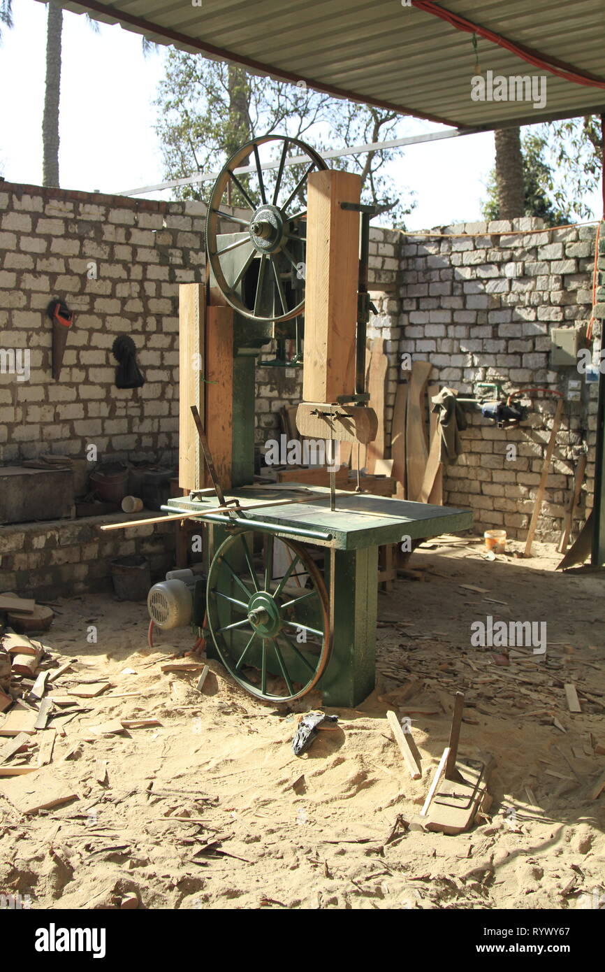 Homemade bandsaw and wood scraps at a carpentry/woodworker's shop in Abusir, Cairo Governorate, Lower Egypt - Stock Image
