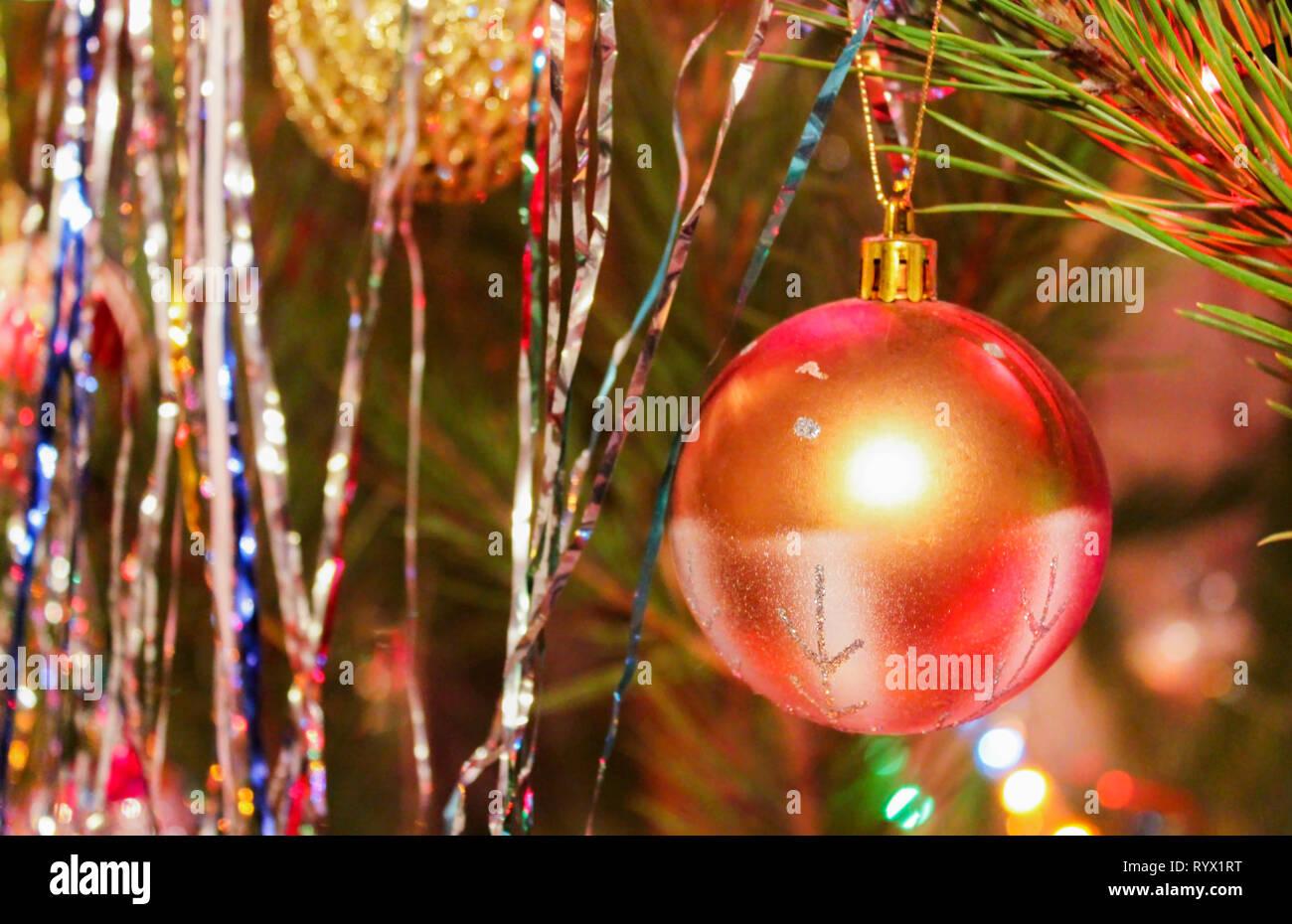 Christmas Ball Garlands.Shiny Christmas Ball On Decorated Rain And Garlands