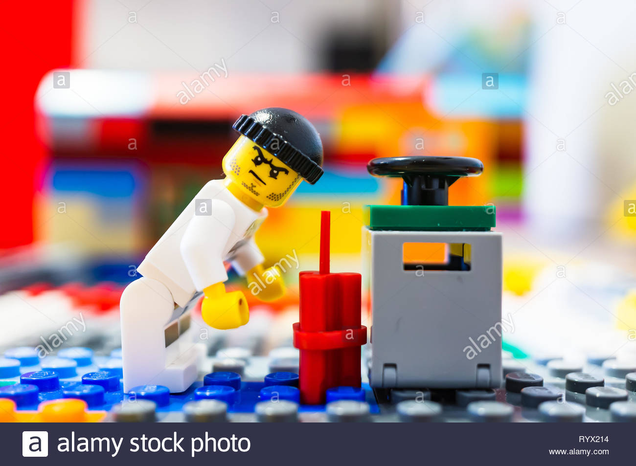 Poznan, Poland - March 14, 2019: Lego escaped prisoner tries to blow up a safe with dynamite. Stock Photo