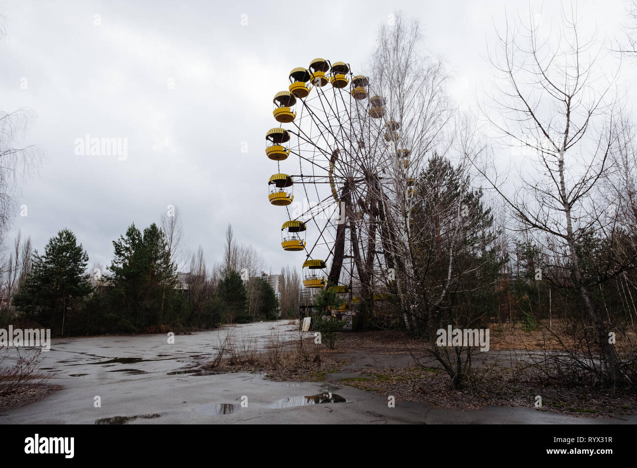 Ferris wheel part of the never opened amusement park in the abandoned city of Pripyat, Chernobyl nuclear power plant disaster exclusion zone, Ukraine. - Stock Image