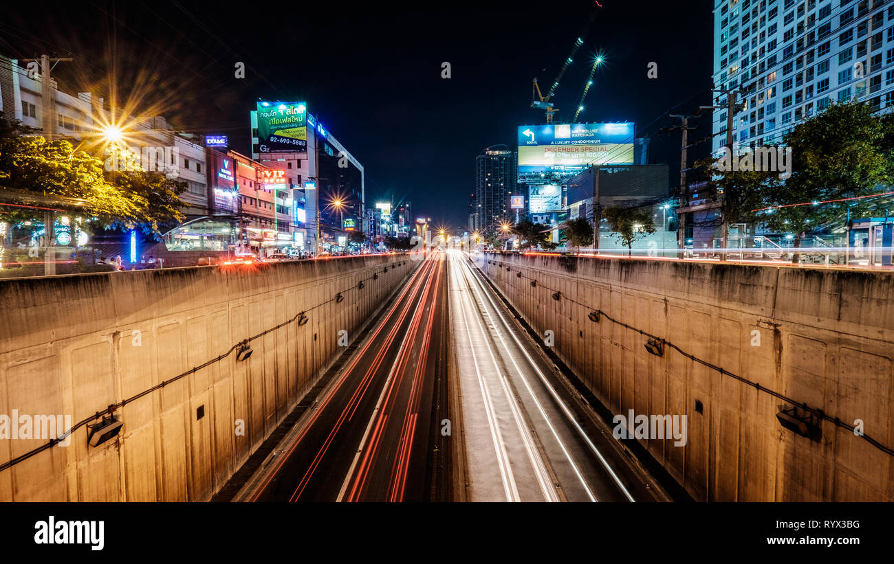 Bangkok - Thailand / 11 Nov 2014: Landscape long exposure shot of a busy highway in Bangkok. The city is experiencing fast growth and modern transform - Stock Image