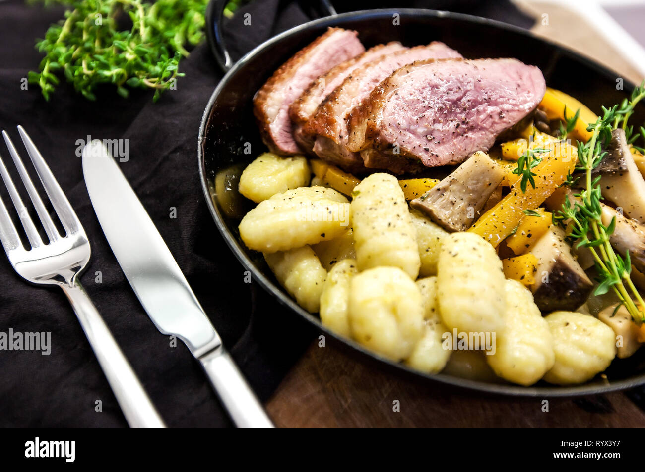 Roasted duck with pear,marinated in red wine Stock Photo