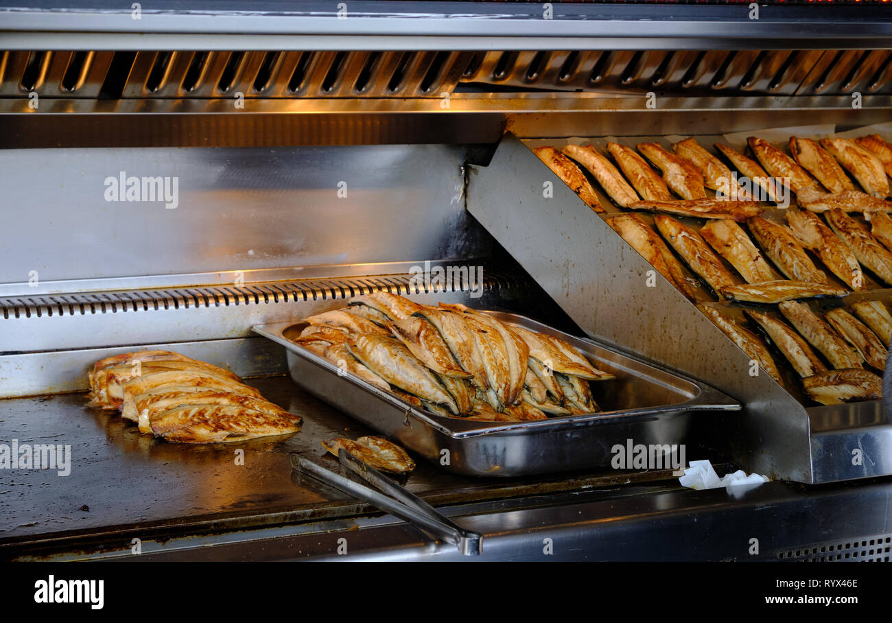 Traditional fishfilets being grilled to make sandwich served on the dock of Eminonu area of Istanbul. Stock Photo