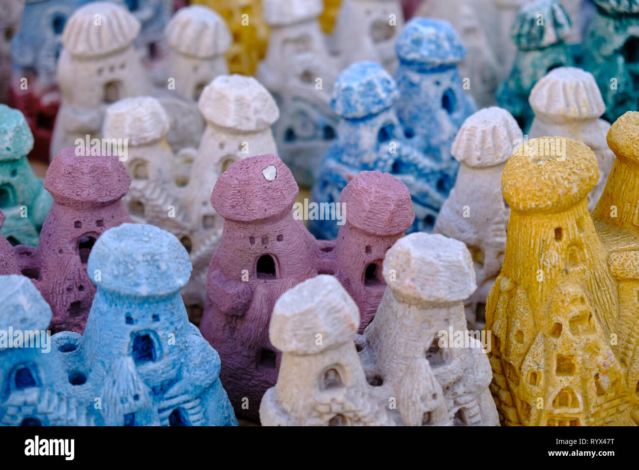 Souvenir of Cappadocia, grouping of colourful reproduction of the castle of Uchisar for offering to tourist. Stock Photo