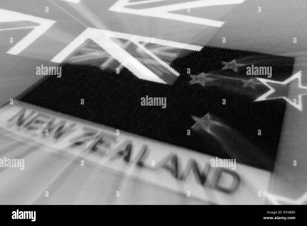 Black and white image of the flag of New Zealand symbolizes mourning. Flying stars symbolize the souls of the dead humans. - Stock Image