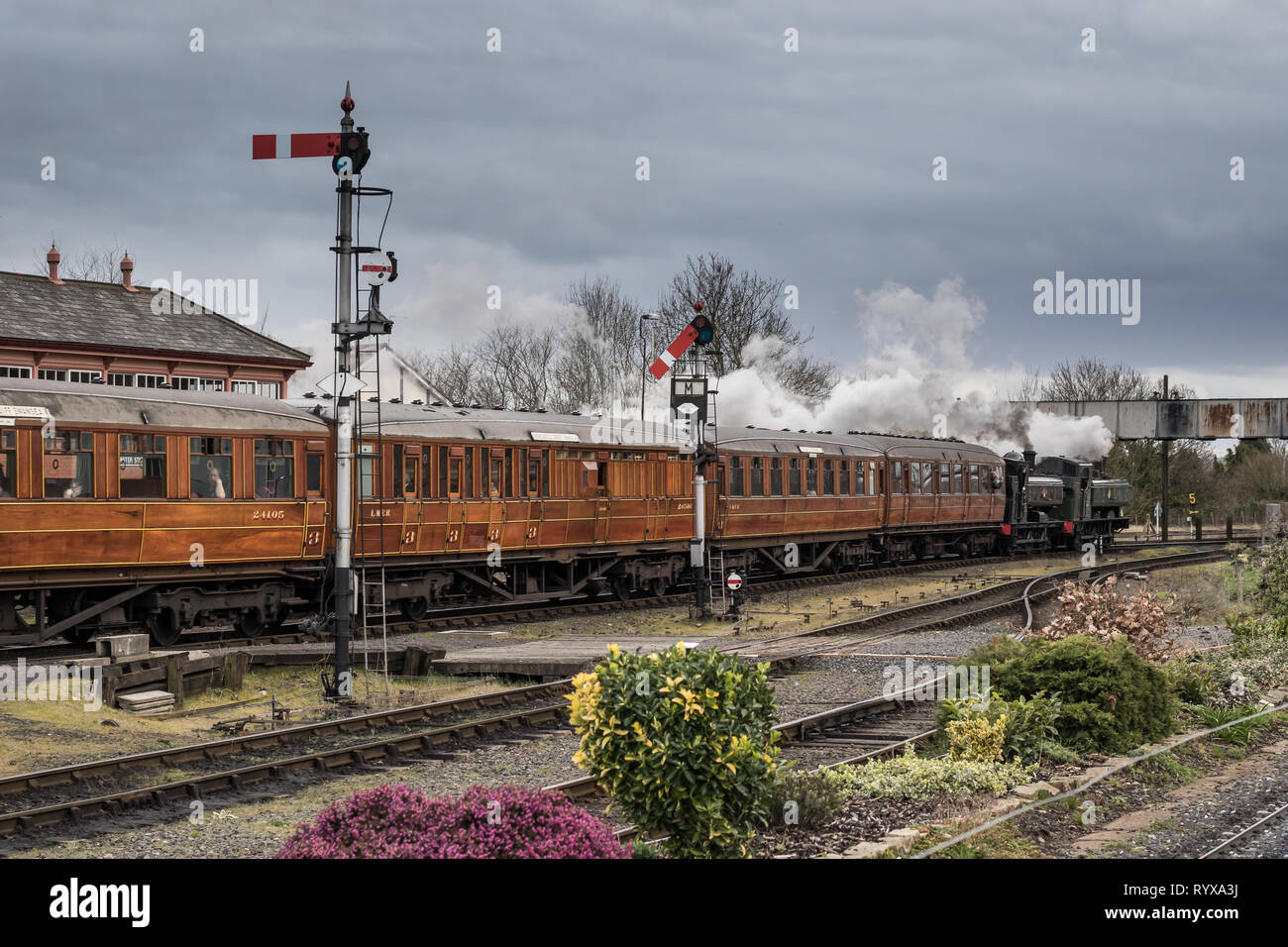 Landscape, side view of vintage steam train leaving Kidderminster SVR station pulled by two vintage UK steam locomotives double-heading at the front. - Stock Image