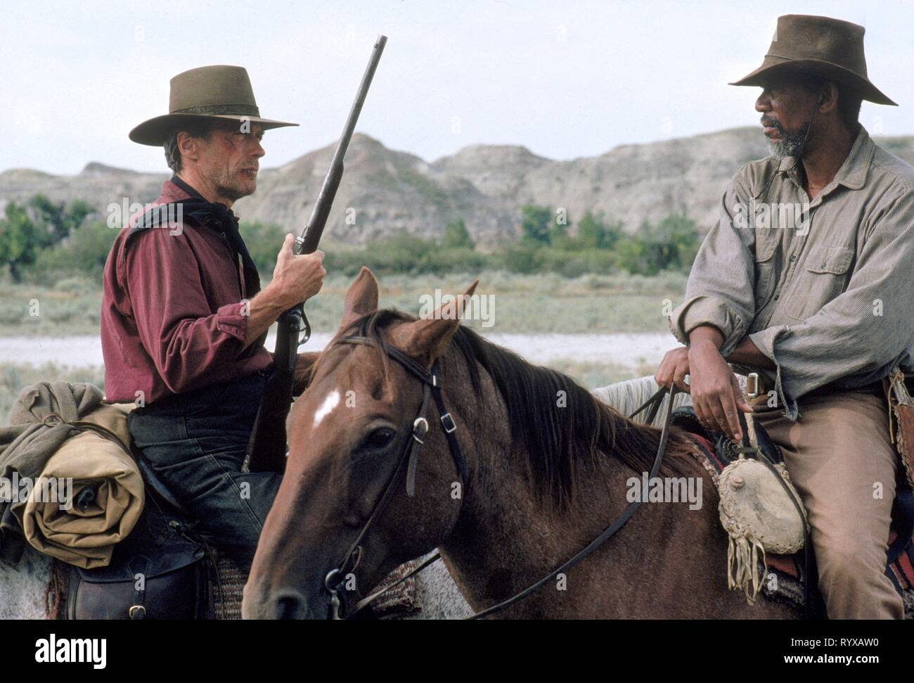 CLINT EASTWOOD, MORGAN FREEMAN, UNFORGIVEN, 1992 Stock Photo