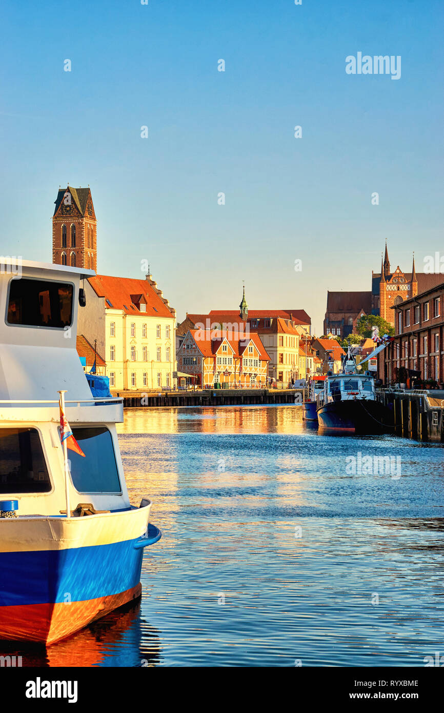 Old harbor of Wismar with boat and view of the old town. Baltic Sea in Mecklenburg Vorpommern. Germany - Stock Image