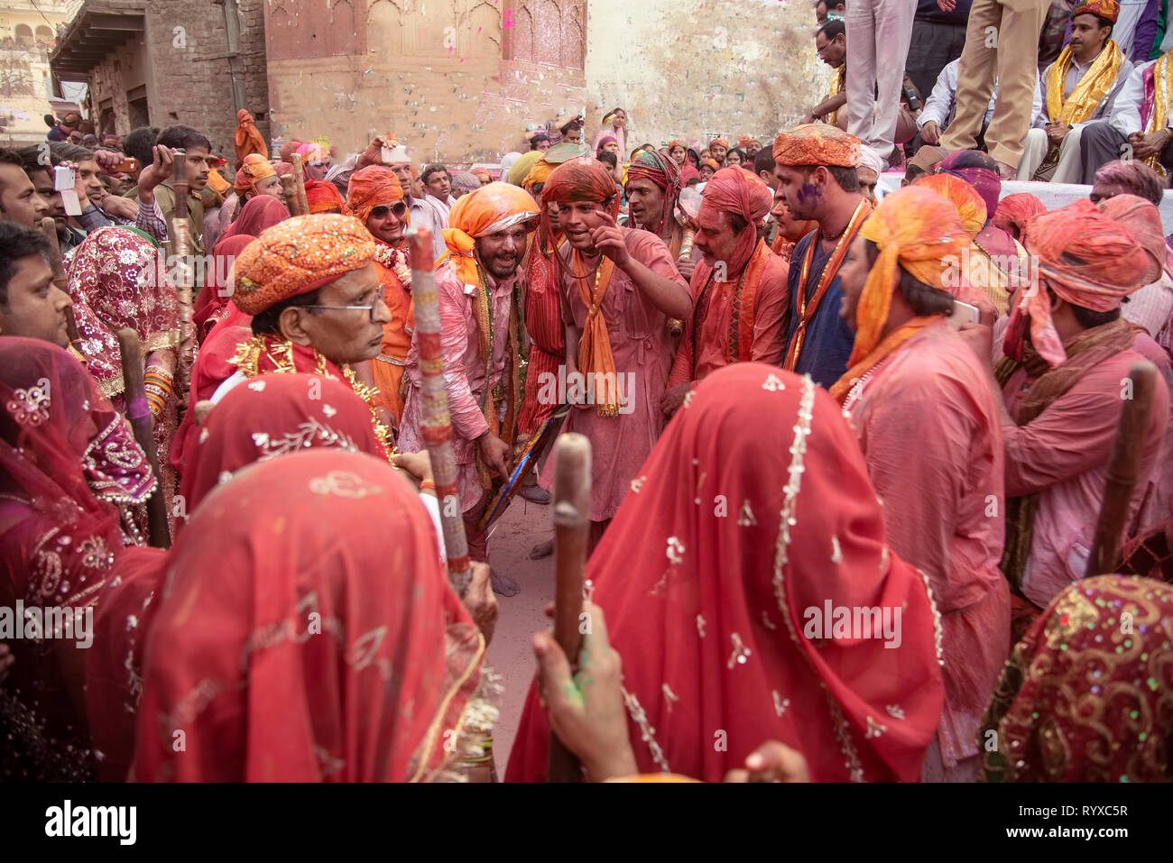 Lathimar Holi performanc e by males,females,recreating,centuries ,old ritual,associated with Lord Krishna,His Gopi & Gopini escorts. ,beating,defendin - Stock Image