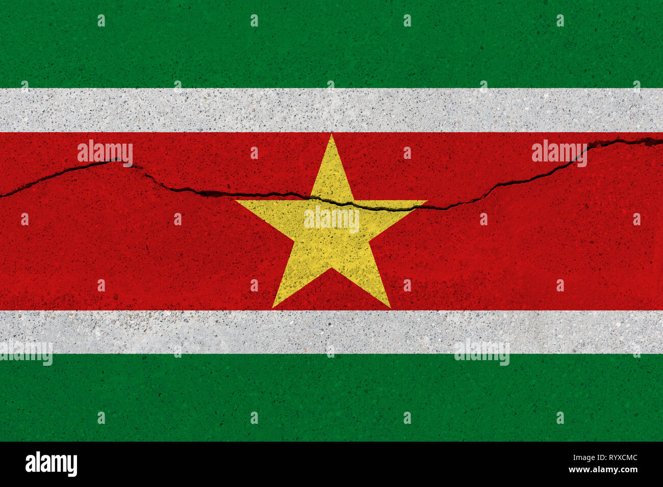 Suriname flag on concrete wall with crack. Patriotic grunge background. National flag of Suriname - Stock Image