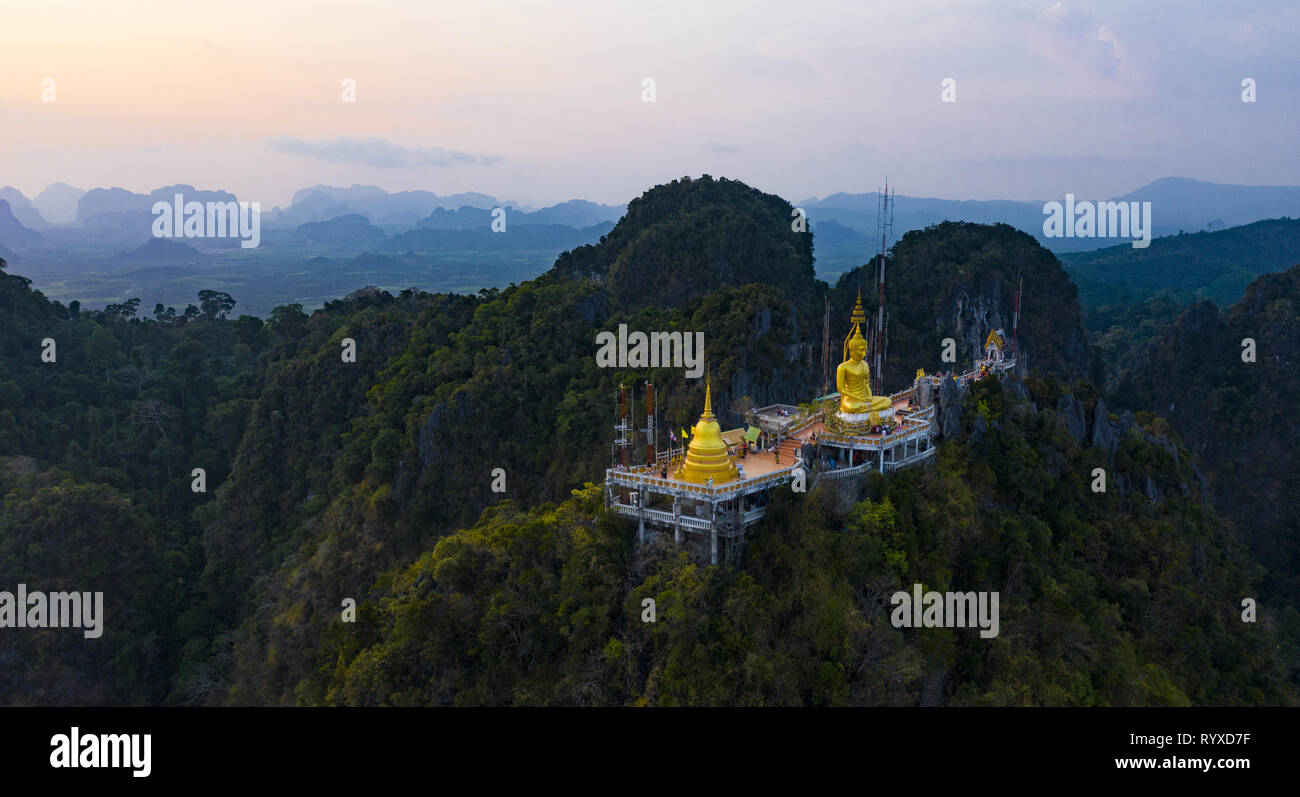View from above, stunning aerial view of the beautiful Tiger Cave Temple (Wat Tham Sua) surrounded by amazing ridges of limestone mountains. - Stock Image