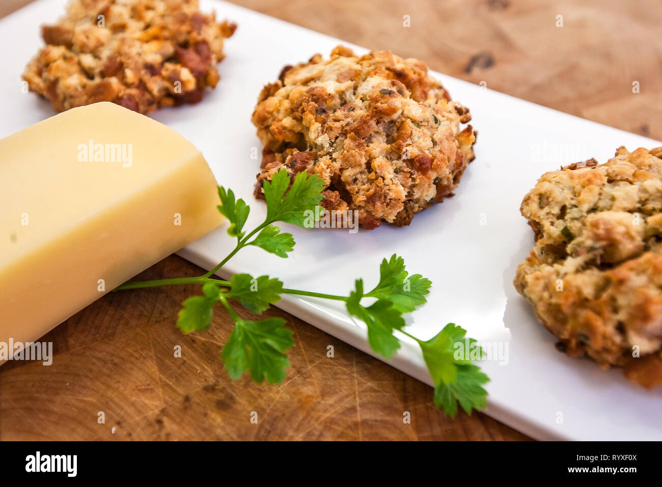 Cheesy bread dumplings with herbs from Austria Stock Photo
