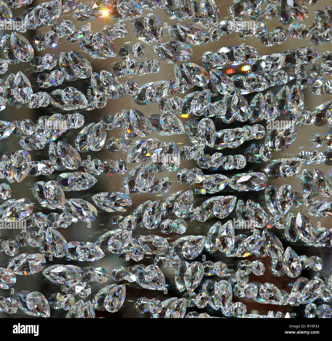 background of many shimmering diamonds symbol of luxury and wealth - Stock Image