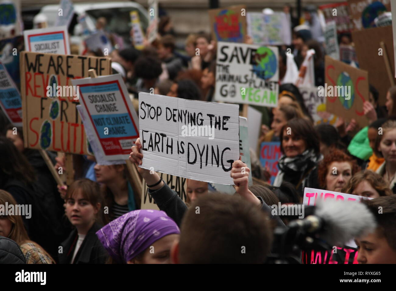 London, UK, 15th March 2019. School and college students in London take part in the second protest calling for the World's governments to make environmental issues a priority. They have walked out of school to gather outside the Houses of Parliament, and march around the capital, stopping at Buckingham Palace. It is one of many protests taking place at the same time around the country. Roland Ravenhill/Alamy Live News. Stock Photo
