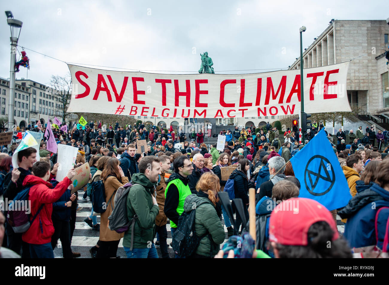 A huge banner is seen being held by demonstrators on the street during the Global climate strike for future rally. This Friday, tens of thousands of kids in more of 60 countries went on strike to demand climate change action. The school strike movement was inspired by Swedish teenager Greta Thunberg, who has been striking from school every Friday since last August to stand outside the Swedish parliament building and demand that her home country adheres to the Paris agreement on climate change. In Brussels, not just students, but teachers, scientists, and several syndicates took the streets of  Stock Photo