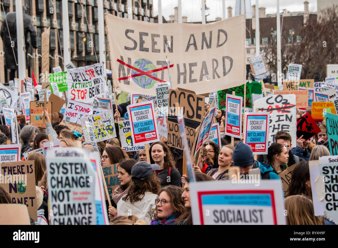 London, UK. 15th Mar 2019. Rallying in Parliament Square - School students go on strike over the lack of action on climate change. They gather in Parliament square and march on Downing Street, blocking the streets around Westminster for over an hour. Credit: Guy Bell/Alamy Live News Stock Photo