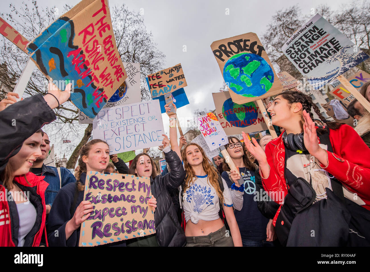 London, UK. 15th Mar 2019. Marching down Whitehall to Downing Street -School students go on strike over the lack of action on climate change. They gather in Parliament square and march on Downing Street, blocking the streets around Westminster for over an hour. Credit: Guy Bell/Alamy Live News Stock Photo