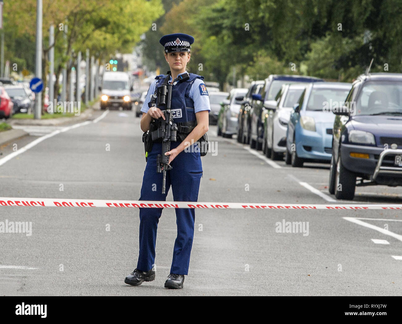 Christchurch, Canterbury, New Zealand. 15th Mar, 2019. Armed police seal off street to Masjid Al Noor mosque, one of two mosques where gunmen attacked and killed 49 people and another 48 were injured. Four people have been arrested and several bombs were found following the shootings. New Zealand Police have charged a man in his late twenties with murder. NZ authorities have named one of the suspects as Brenton Tarrant. Credit: PJ Heller/ZUMA Wire/Alamy Live News - Stock Image