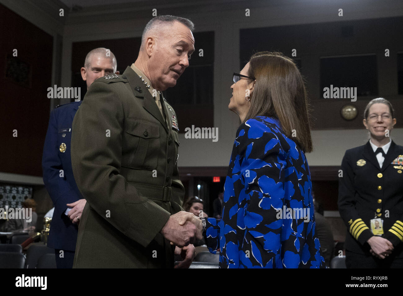 Washington, District of Columbia, USA. 14th Mar, 2019. General JOSEPH F. DUNFORD, Jr. greets Senator Martha McSally (R-AZ) at a Senate Armed Services Committee Hearing on Department of Defense Budget Posture, March 14, 2019 Credit: Douglas Christian/ZUMA Wire/Alamy Live News Stock Photo