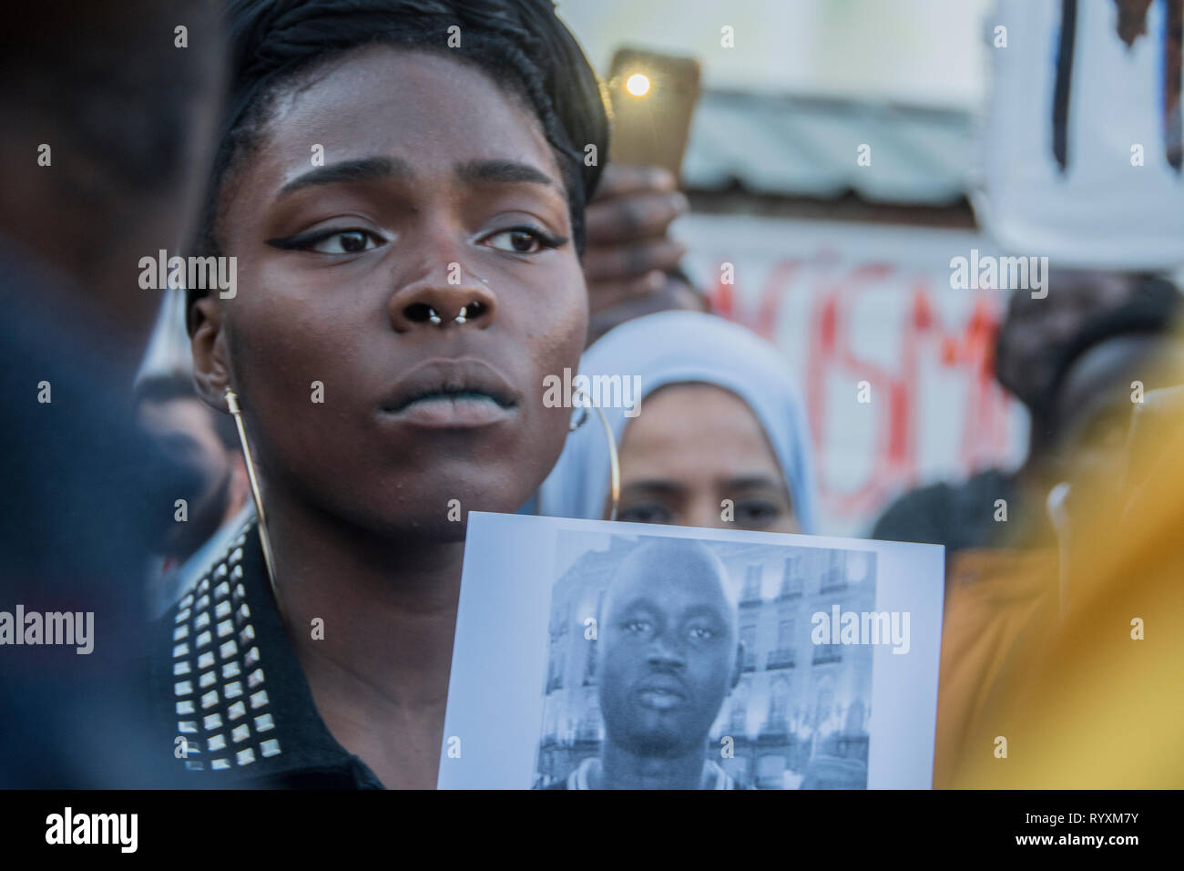 Madrid, Spain. 15th Mar 2019. March to commemorate one year of the death of senegalese vendor Mmame Mbage in Lavapies Square Nelson Mandela. one year ago there was a clashes between police and immigrants after Mmame Mbage, a Senegalese street vendor, died of a cardiac arrest allegedly after being chased by local police. Credit: Alberto Sibaja Ramírez/Alamy Live News - Stock Image