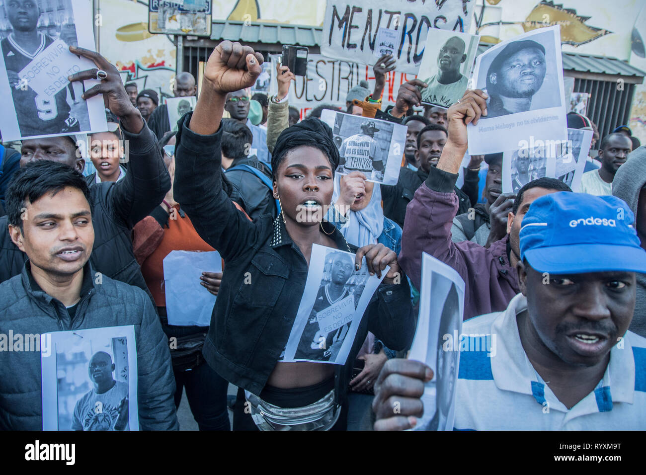 Madrid, Spain. 15th Mar 2019. People screaming 'no more instiutional racism in Madrid, Spain' March to commemorate one year of the death of senegalese vendor Mmame Mbage in Lavapies Square Nelson Mandela. one year ago there was a clashes between police and immigrants after Mmame Mbage, a Senegalese street vendor, died of a cardiac arrest allegedly after being chased by local police. Credit: Alberto Sibaja Ramírez/Alamy Live News - Stock Image