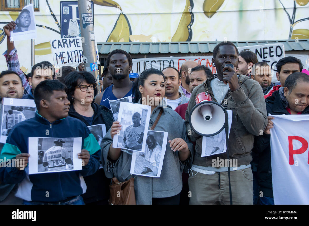 Madrid, Spain. 15th Mar 2019. A protest against institutional racism took place at Nelson Mandela square in Madrid one year after the death of Mame Mbaye, a Senegalese street vendor who died while being chased be the police for selling on the streets. According to the demonstratord, the young man did not have any legal papers despite having spent more than 10 years in Spain and authorities did not help his family after his death.   The protesters asked for justice and reported that they are constantly ignored and discriminated by Spanish authorities. Credit: Lora Grigorova/Alamy Live News - Stock Image