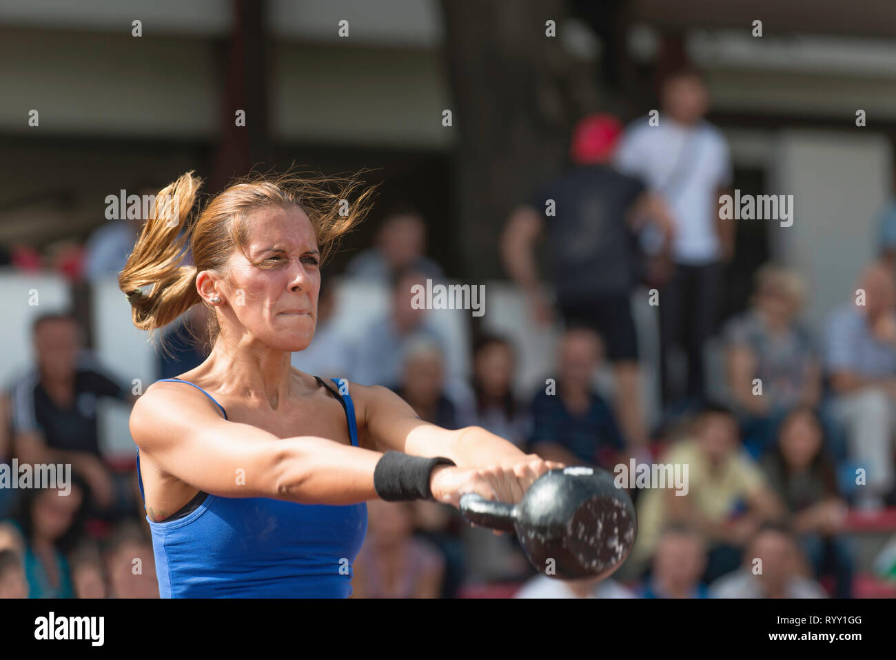 Kettlebell swing competition. - Stock Image