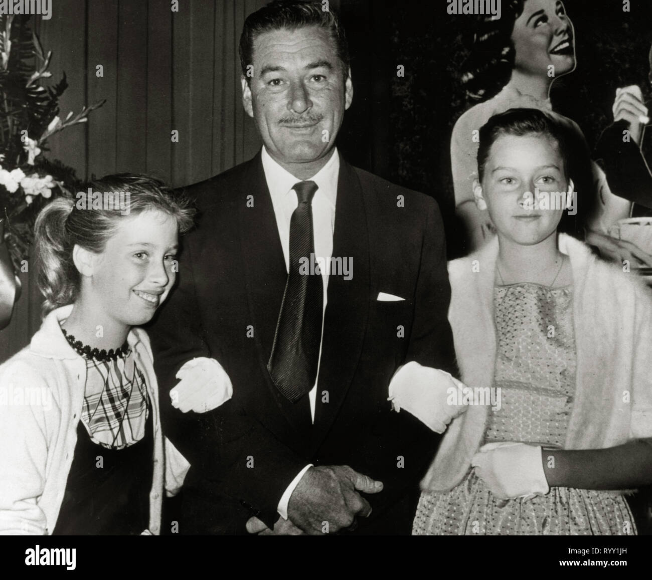 Errol Flynn, with his daughters, Rory (left) and Deirdre circa (1957) File Reference # 33751 909THA Stock Photo
