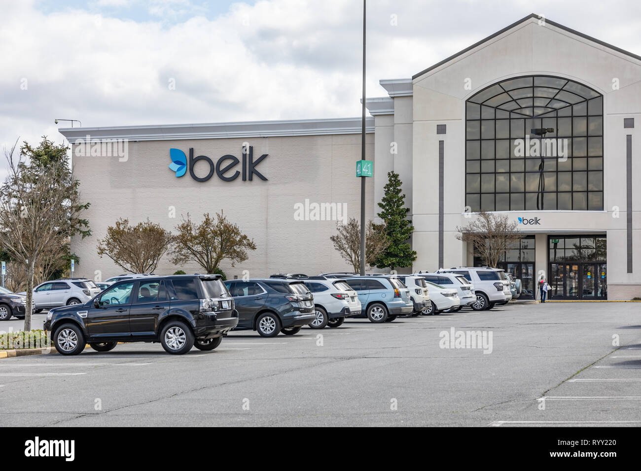 GASTONIA, NC, USA-3/14/19: Belk department store in Eastridge Mall, with person in parking lot. Stock Photo