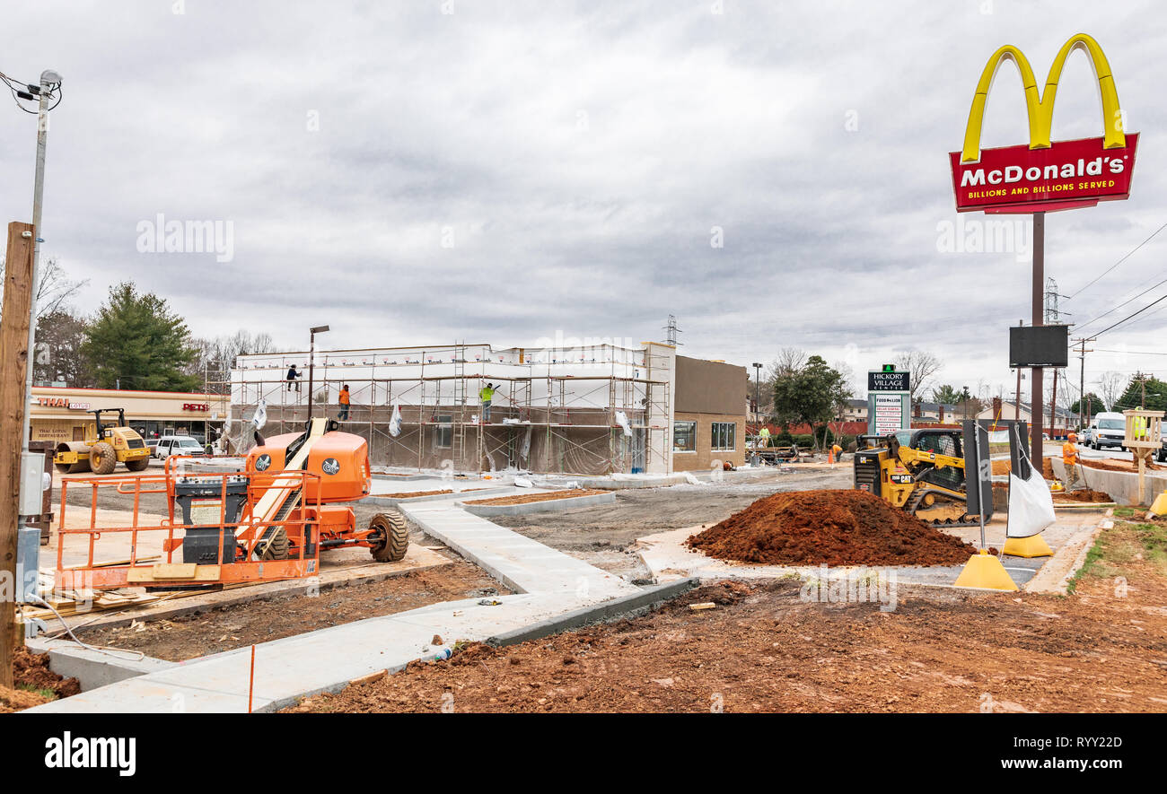 HICKORY, NC, USA-3/14/19: A remodeling takes place on an older McDonald's restaurant building.  Construction workers visible. Stock Photo