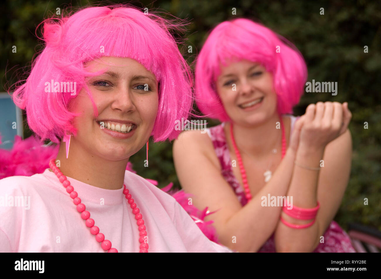 Pink Car Rally on the A38 en route for Birmingham, where mainly women were dressed in pink driving pink cars Stock Photo