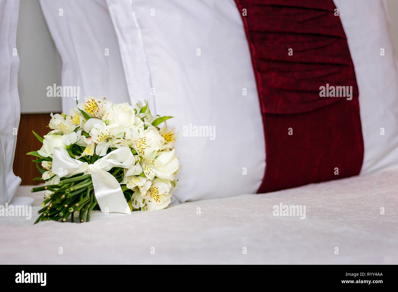 White Wedding Bouquet On The Bed White Wedding Flowers On Bed Romantic Image Stock Photo Alamy