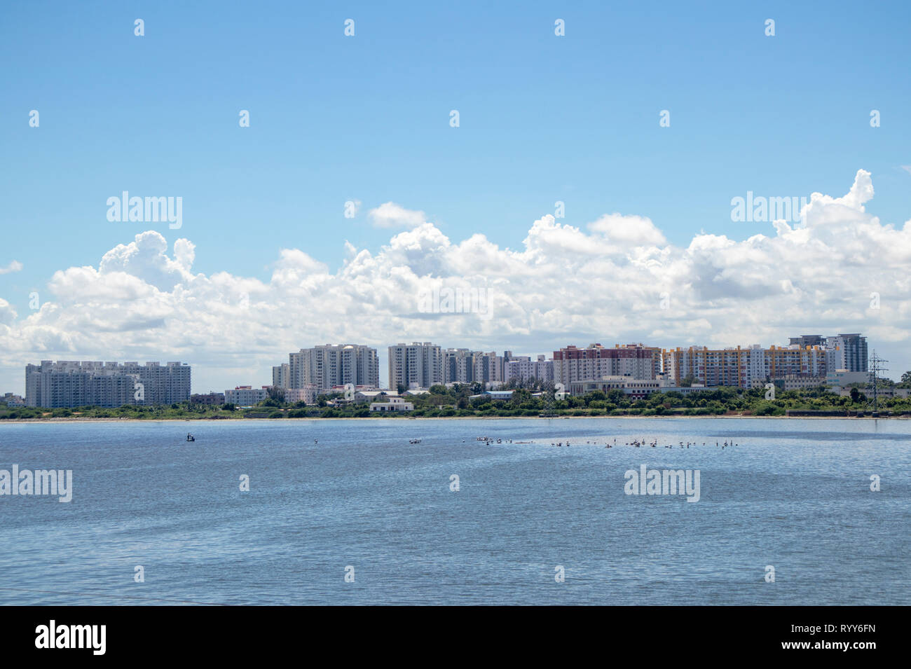 City scape Lake view Apartment buildings at ECR Chennai found along the backwaters of Muttukadu - Stock Image