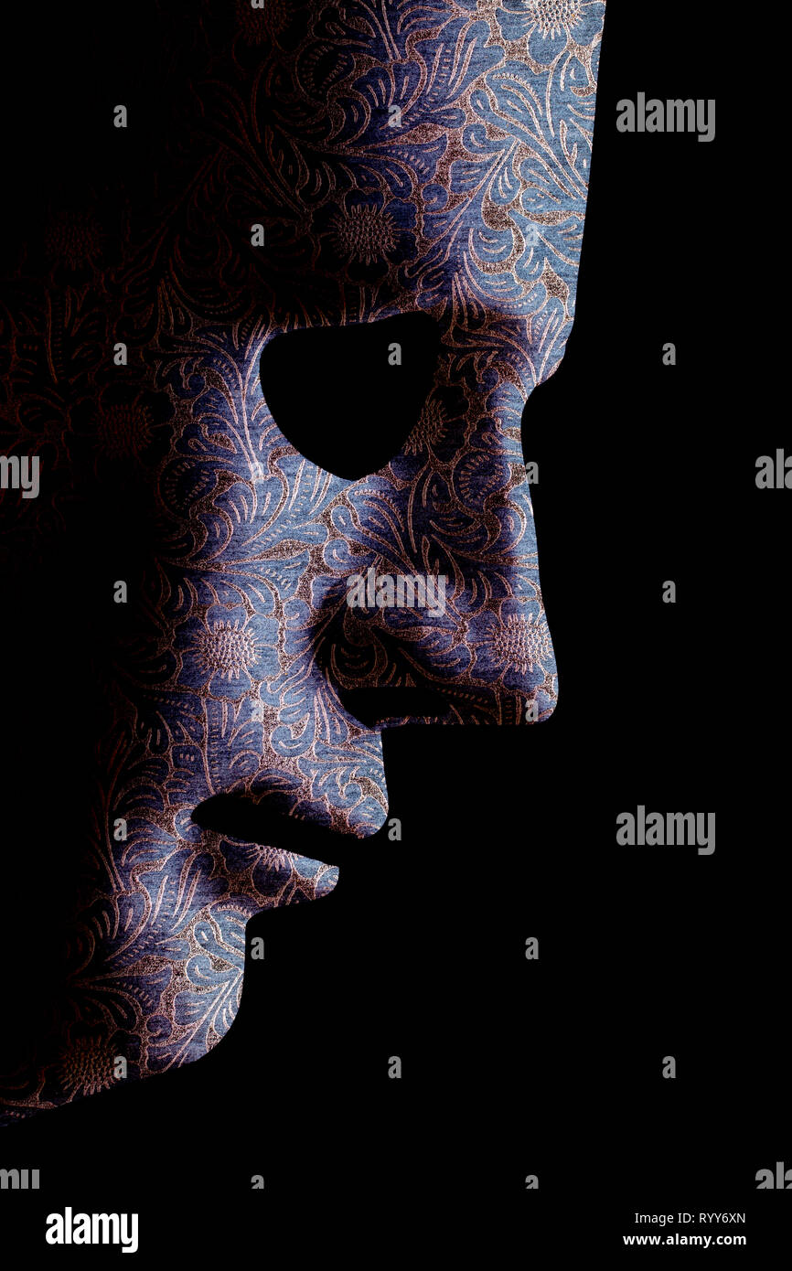 Robot face mask side view close up with textured skin and blank eyes. Black background and space for text. Artificial intelligence concept in a human  - Stock Image