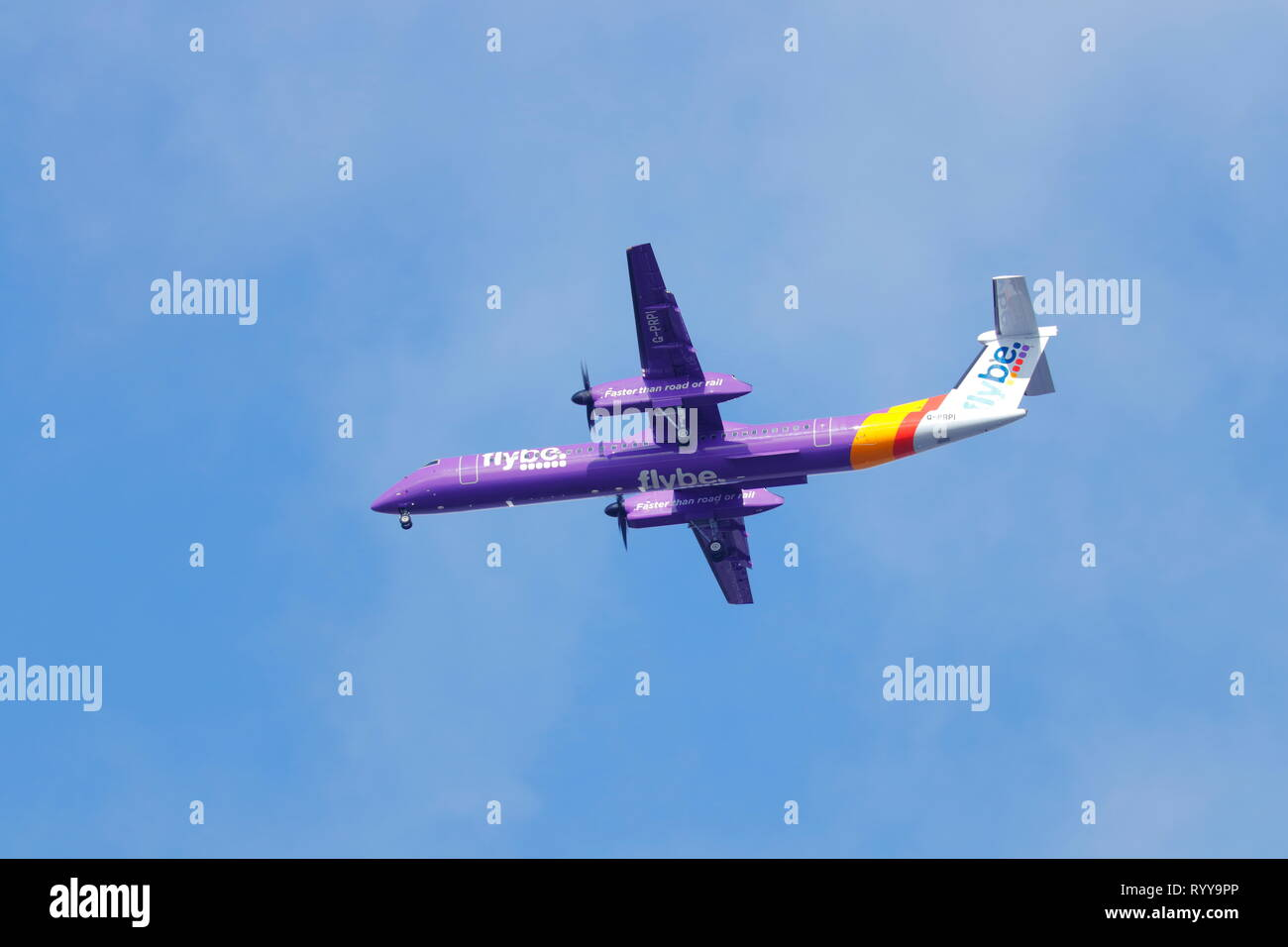 Flybe De Havilland Bombardier Dash 8 on final approach to Leeds Bradford International Airport. - Stock Image