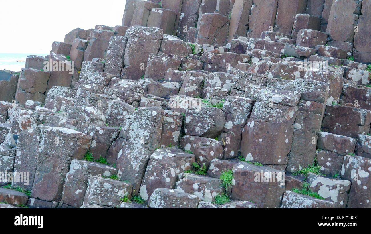 The formations of basalt rock columns found in Giants Causeway in Northern Ireland - Stock Image