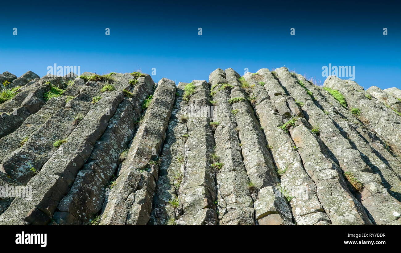 Closer look of the vertical rock formation in Giants Causeway in the Northern Ireland Stock Photo