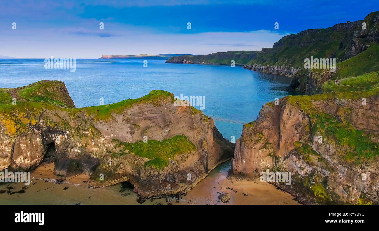 The big rocks of the cliff in Carrick-a-Rede. Carrick-a-Rede Rope Bridge is a famous rope bridge near Ballintoy in County Antrim Northern Ireland. - Stock Image