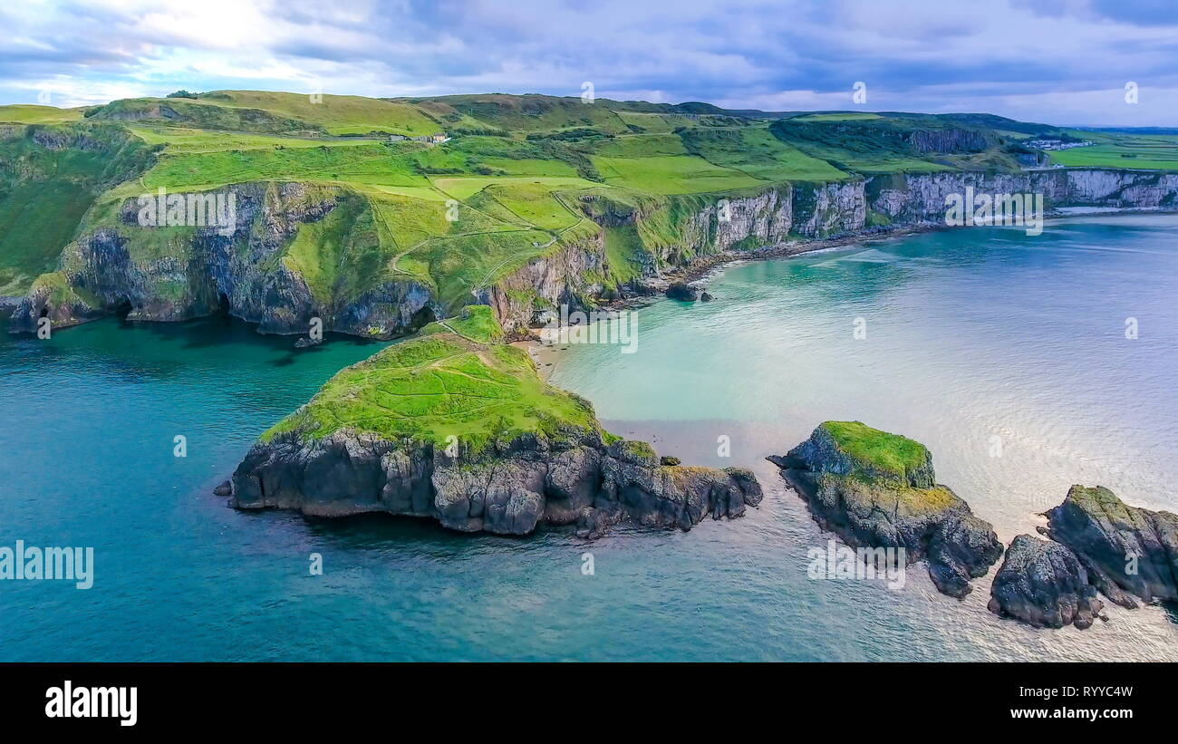 The aerial view of the two islands in Carrick-a-Rede with the rope bridge connecting the two islands in Ireland - Stock Image