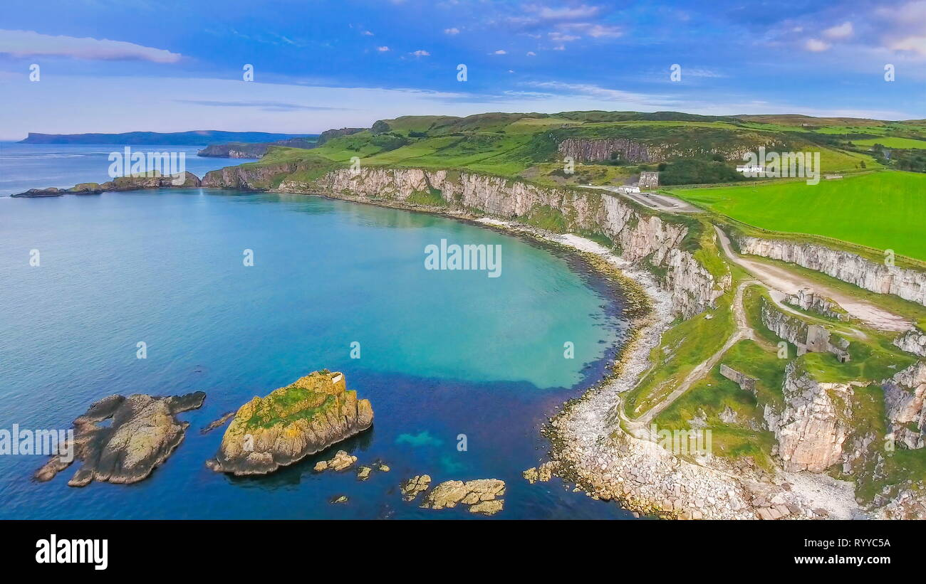The view of the small islands on the sea in Carrick-a-Rede small islands formed on the sea fronting the big cliff of the mainland in North Ireland in  - Stock Image