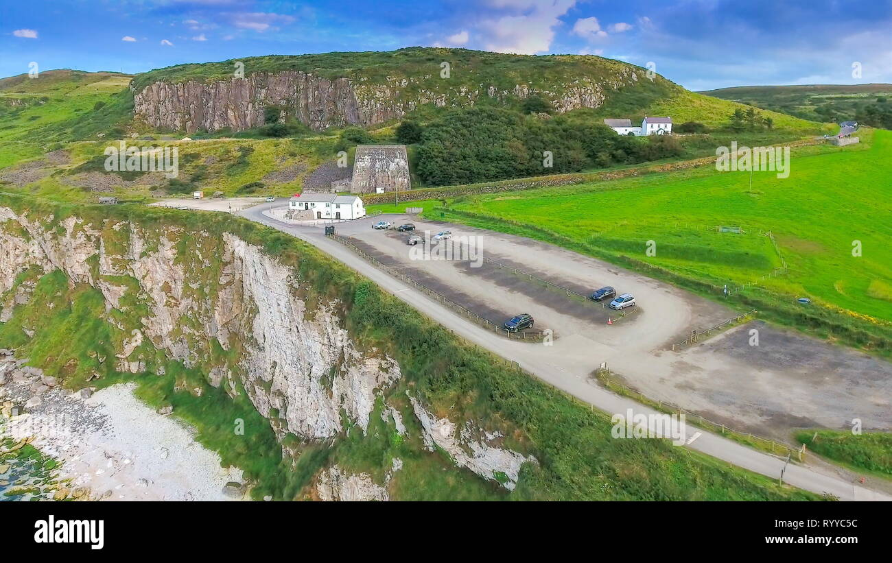 Closer look of the parking lot in the cliff where tourists visiting Carrick-a-Rede parked their cars in Ireland - Stock Image