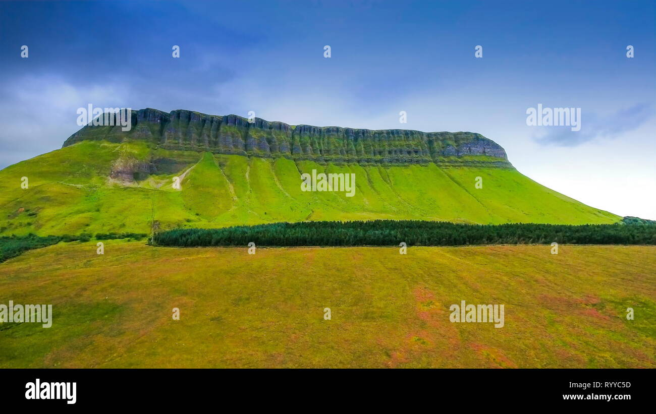The landscape view of the Benbulbin holy mountain. Benbulbin sometimes spelled Ben Bulben or Benbulben is a large rock formation in County Sligo Irela - Stock Image