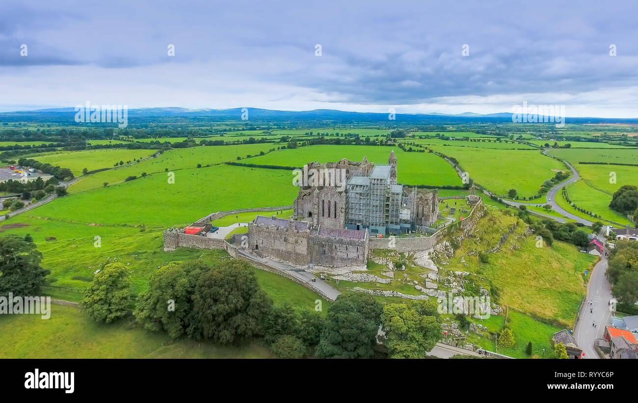 The aerial view of the Rock of Cashel and the green fields on the back of the old ruined castle in Ireland - Stock Image