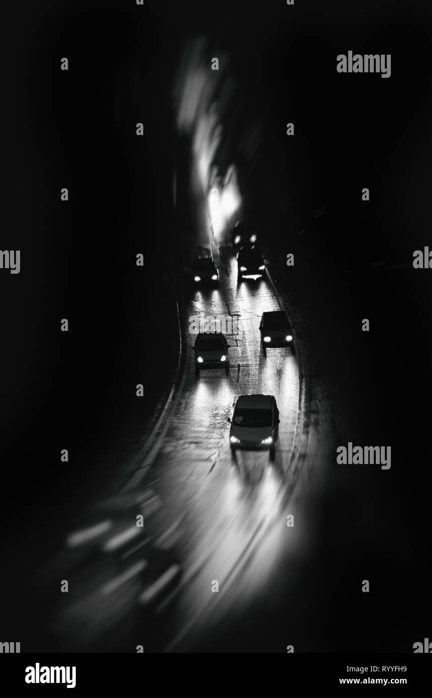 Cars Driving In The Rain At Night Motion Blur Black And