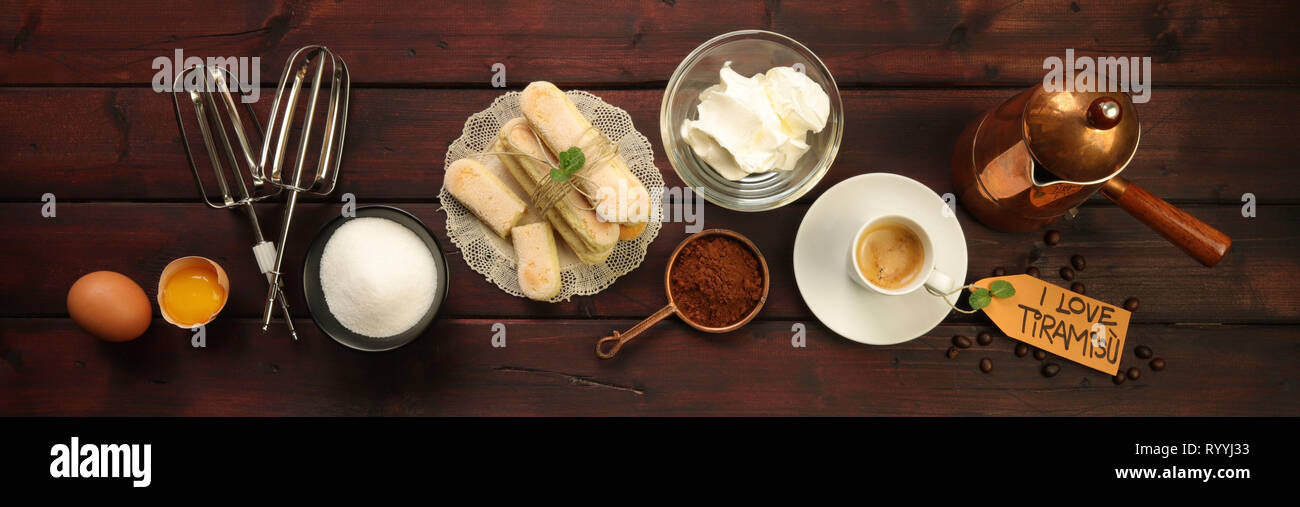 Ingredients for tiramisu with tag on wooden table - Stock Image