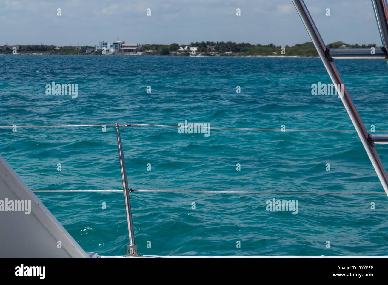 sailboat handrail in the caribbean. metal handrail against crystal clear caribbean water - Stock Image
