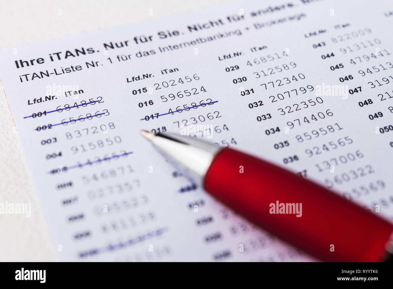 iTan-list with pen and computer keyboard - Stock Image