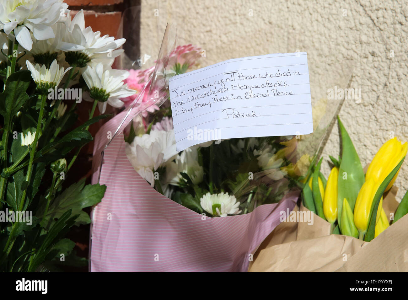 Finsbury Park Mosque, London, UK 15 Mar 2019 - Flowers and a message left at the entrance to Finsbury Park Mosque in north London, after Christchurch attack, in New Zealand in which 49 people died following a shooting at two mosques and a man in his late twenties has been charge with murder.  Credit: Dinendra Haria/Alamy Live News - Stock Image