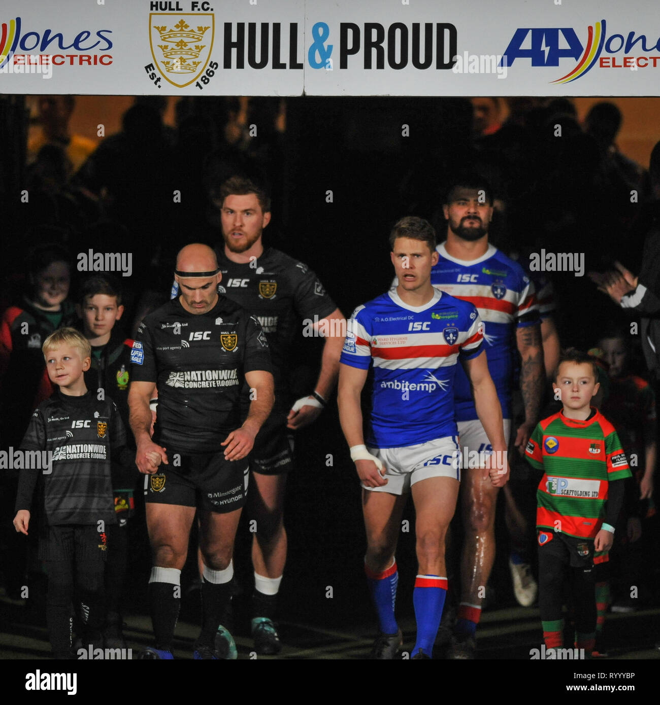 Hull, UK, 15 3 2019. 15 March 2019. KCOM Stadium, Hull, England; Rugby League Betfred Super League, Hull FC vs Wakefield Trinity; Danny Houghton and Jacob Miller lead out the teams.  Dean Williams Credit: Dean Williams/Alamy Live News Stock Photo