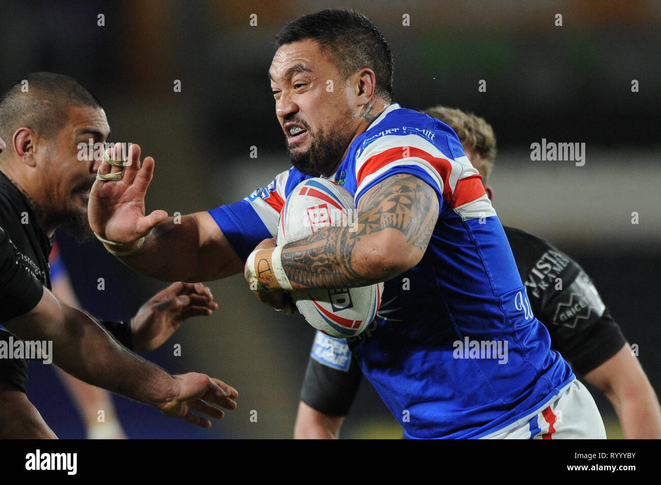 Hull, UK, 15 3 2019. 15 March 2019. KCOM Stadium, Hull, England; Rugby League Betfred Super League, Hull FC vs Wakefield Trinity; Tinirau Arona fends off the Hull FC defence.  Dean Williams Credit: Dean Williams/Alamy Live News Stock Photo